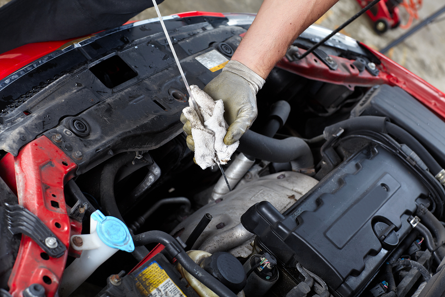 Oil Level Checking Mechanic In Auto Repair Shop
